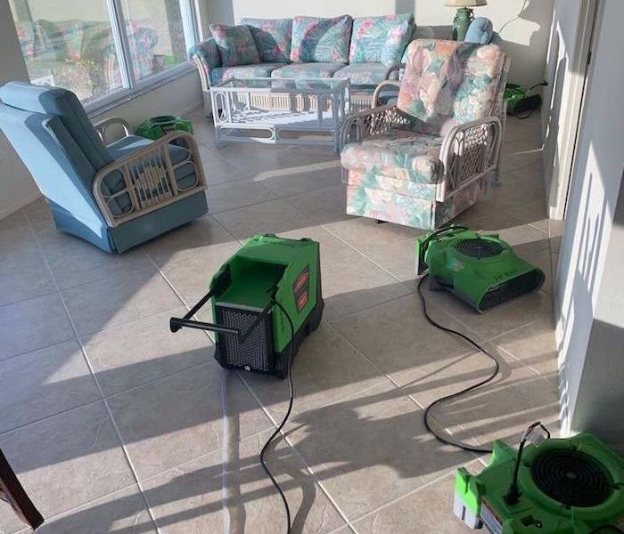 Sunlit living room with SERVPRO drying equipment