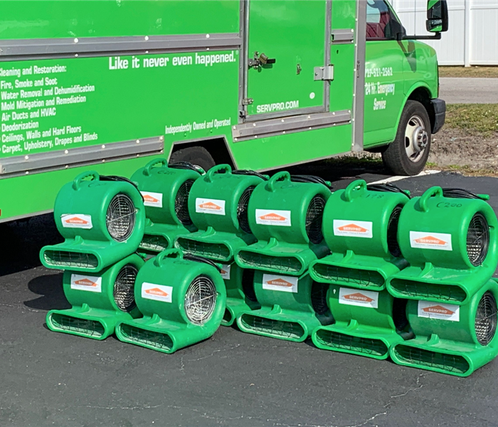 A SERVPRO vehicle with equipment.