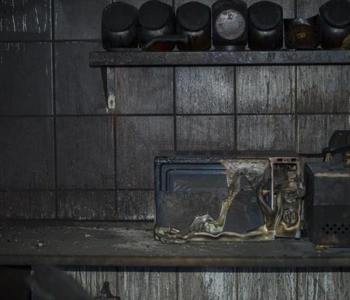 fire damaged kitchen with microwave