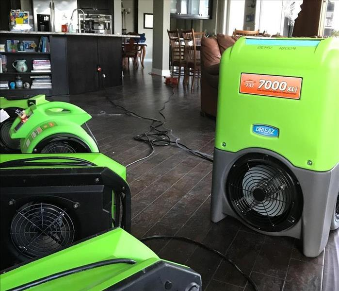 SERVPRO equipment on the floor in a kitchen.
